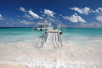 Caribbean beach, jetty and ferry boat