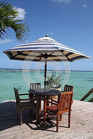 Caribbean beach table under a palm tree