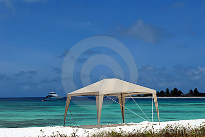 Caribbean beach,tent and yacht