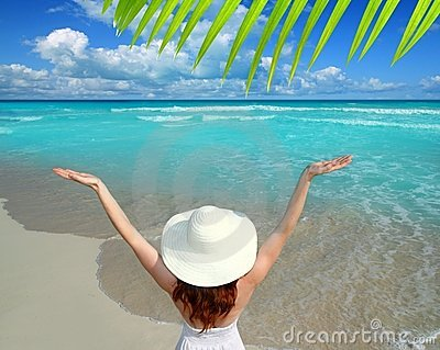 Caribbean beach woman rear view hat open arms
