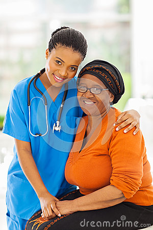 Caring african nurse patient