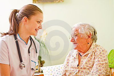 Caring doctor with elderly woman
