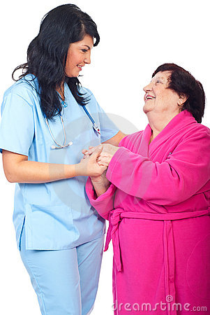 Caring doctor holding elderly woman  hands