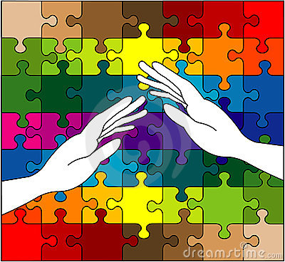 Caring hands on colorful puzzle
