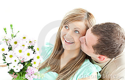 Caring man giving a bouquet to his girlfriend
