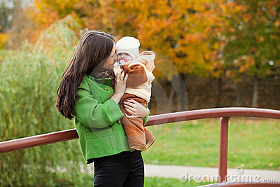 Caring mother with baby in park