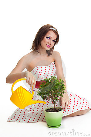 Caring woman water a plant