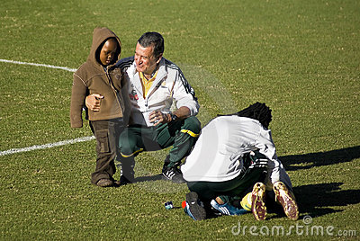 Carlos Alberto Parreira and Kid - Coaching Advise Editorial Stock Image