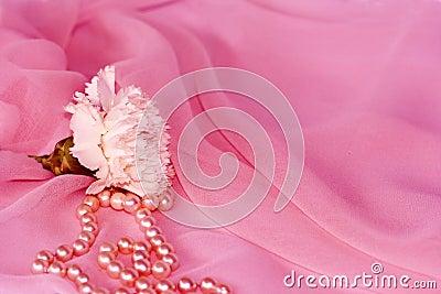 Carnation and pearls on pink silk chiffon