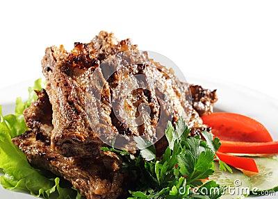 Carne de vaca (o cerdo) asado a la parilla