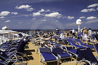 Carnival Cruise Ship - Sunning on the top deck Editorial Photography
