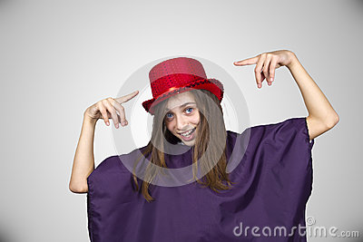Carnival girl with funny face and red hat