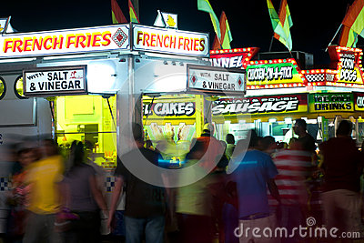 Carnival Goers Walk Among Fast Food Vendors Editorial Image