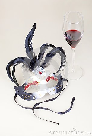 Carnival mask and glass of wine