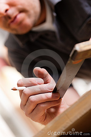 Carpenter with angle and pencil