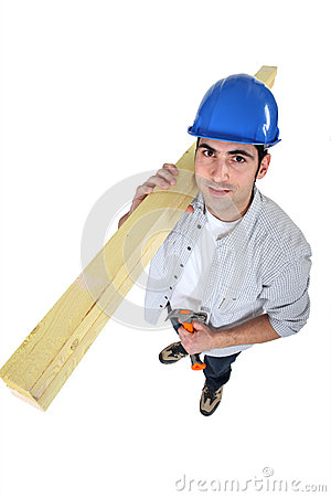 Carpenter carrying planks