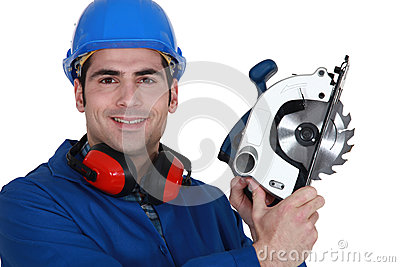 Carpenter with a circular saw.
