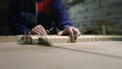 Carpenter cutting wooden plank with table saw stock video