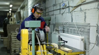 Carpenter drilling holes in dash with bench drill stock footage