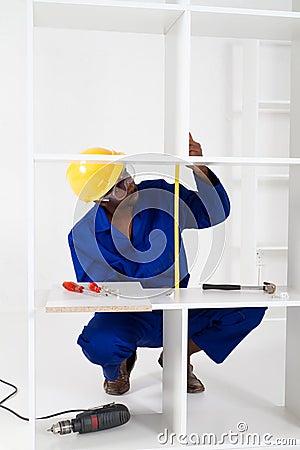 Carpenter making furniture