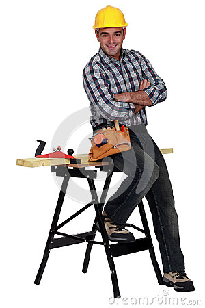 Carpenter next to a workbench