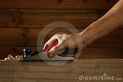 Carpenter planning wood planer tool man hand