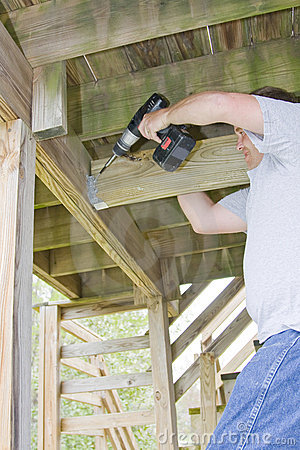Carpenter securing deck