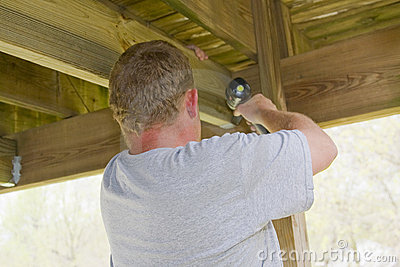 Carpenter securing deck