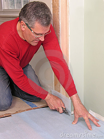 Carpenter using utility knife