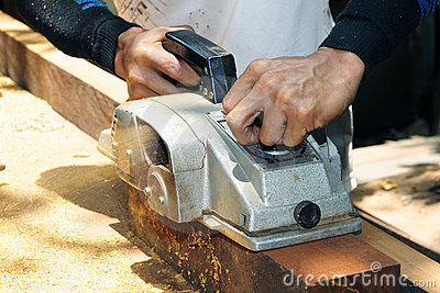 Carpenter using wood sander