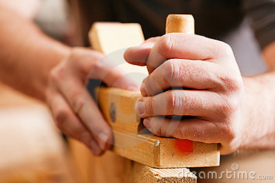 Carpenter With Wood Planer Stock Photo - Image: 14624400