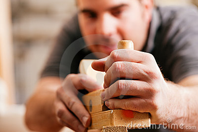 Carpenter with wood planer