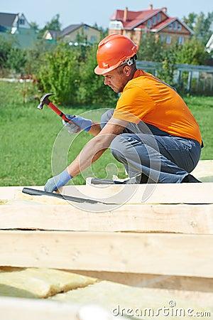 Carpenter works on roof