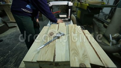 Carpenters planing planks with planing machine stock video footage