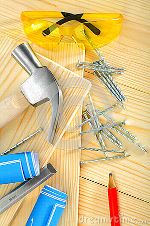 Carpentry tools on  wooden background