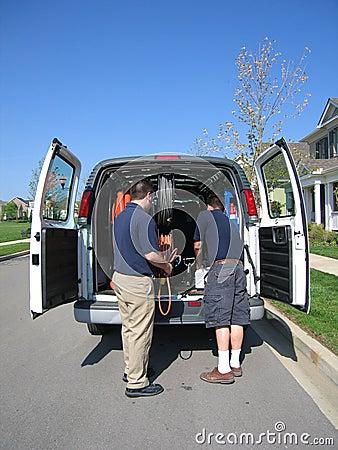 Carpet Cleaners Unload Van