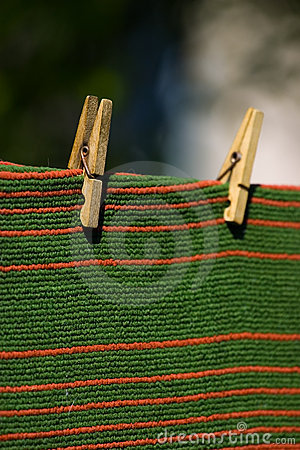Carpet pegged to a clothesline