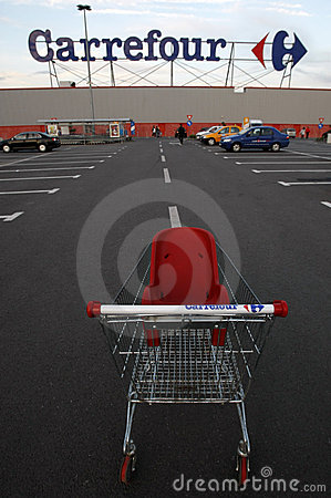Carrefour supermarket logo and shopping cart Editorial Stock Photo
