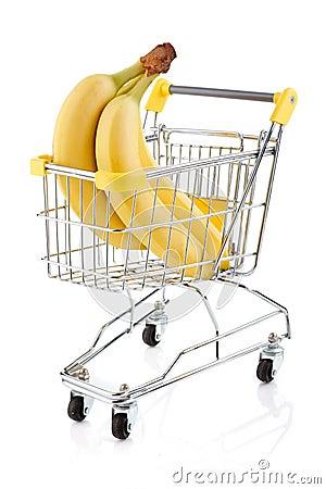 Carrello e banane di acquisto