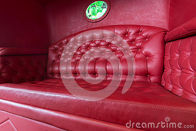 Carriage with red leather sofa