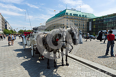 The carriage for tourists walking through the city on Pariser Platz Editorial Photography