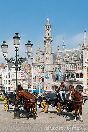 Carriages with cabbies in Bruges Editorial Photo