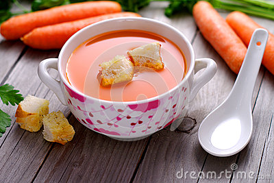 Carrot  soup in a porcelain bowl.