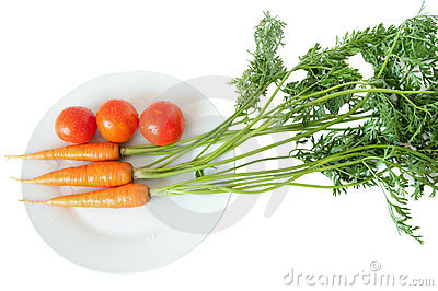 Carrot and tomato on white plate