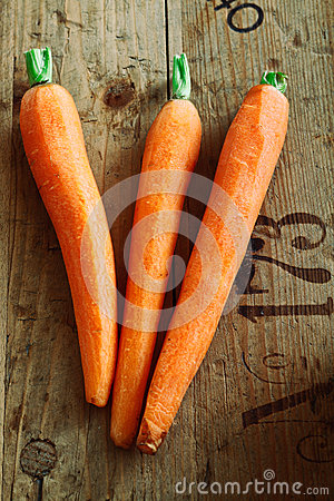 Carrot trio on wood background