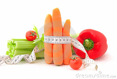 Carrots with tape measure and vegetables
