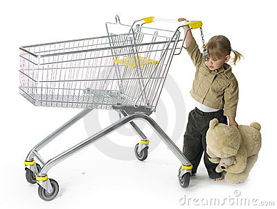 Carrying bear little girl leads shop trolley