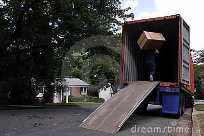 Carrying box into moving truck