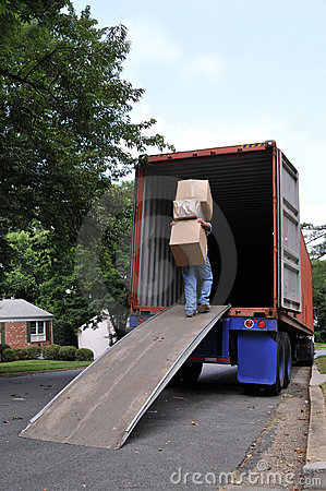Carrying boxes into moving truck