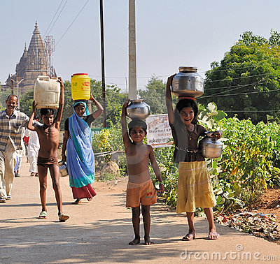 Carrying jugs of water in India Editorial Stock Image